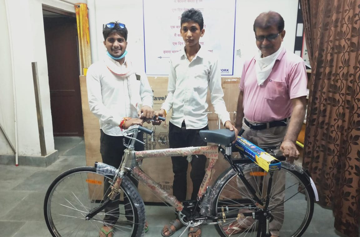 work charitable trust giving cycle to boy